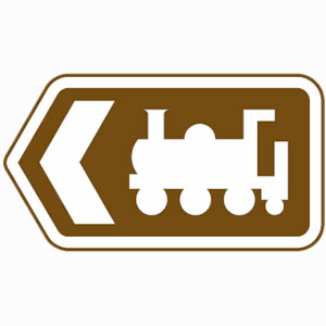 Brown road sign with train