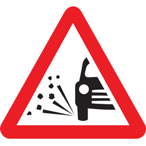 Loose chippng road sign