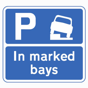 Vehicles may park partially on verge or pavement in bays only sign