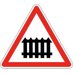 Passage à niveau muni de barrières