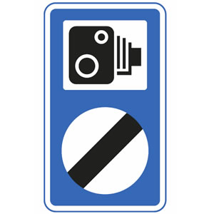 Speed camera on national speed limit road sign