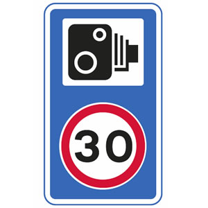 Speed camera on 30mph road sign