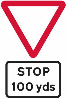 Stop line 100 yards junction sign