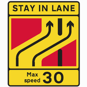 Traffic lanes separate advised speed limit sign