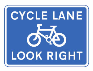 Reminder sign for pedestrians to look out for cyclists