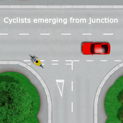 Cyclist Emerging from a Junction