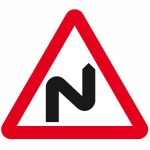 Double bend in road ahead sign