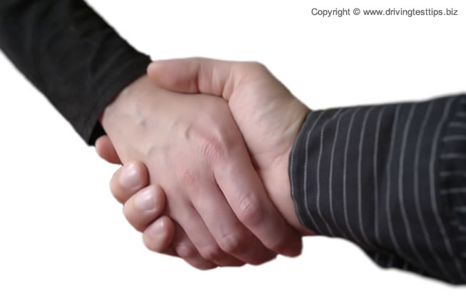 Shaking hand on a new car deal