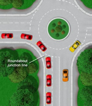 Turning left at roundabout