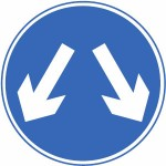 Vehicles may pass either side to reach the same destination sign