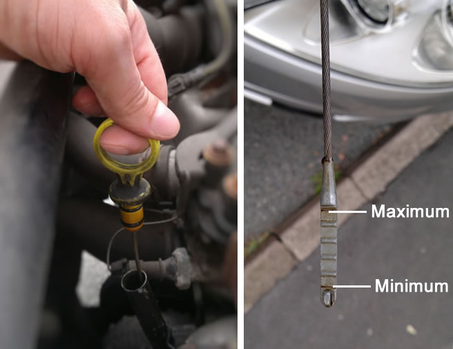 Check engine oil levels by using the dipstick