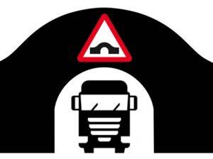 Large vehicle passing though arched bridge