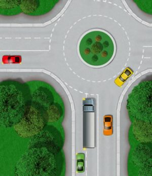 Large vehicle using right lane at roundabout to turn left