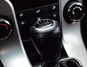 Manual car gear stick. Forward gears 1-5 along with one reverse gear.