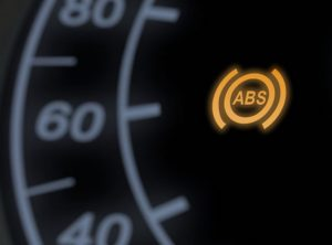 Anti-lock Braking System (ABS) warning light illuminating on car dashboard